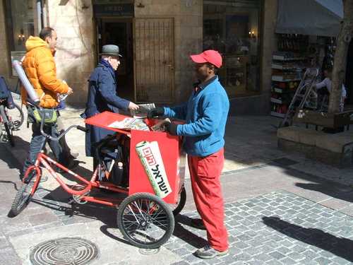 Photo: One of the distinctive newspaper distributors of Sheldon Adelson's Israel Hayom (courtesy Wikimedia)